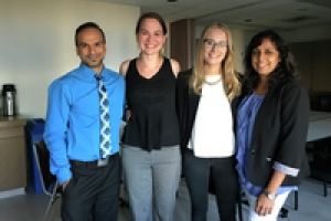 Rupinder Dhaliwal with Dr. Amer Johri (in blue shirt) and his MetS research team